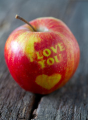 apple with heart and text 'i love you'