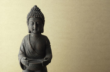 Buddha statue on a beige background
