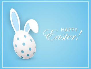 Easter egg with rabbit ears on blue background