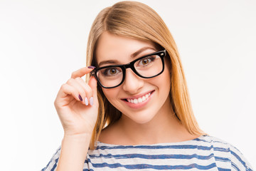 Close up photo of cheerful girl touching her glasses