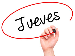 Man Hand writing Jueves (Thursday in Spanish) with black marker