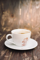 Hot cup coffee on wood background