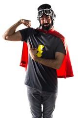 Superhero making strong gesture
