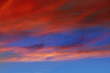 Red orange clouds in dramatic sunset sky