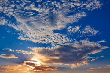 Sunset sky with golden and blue clouds