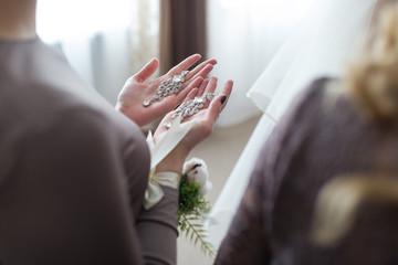 Wedding earrings on a female hand