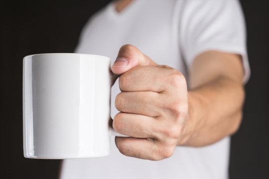 Man in White t-shirt holding Coffee mug