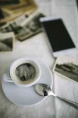 Cup of coffee and photographs on the table