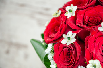 Beautiful bouquets of roses for a wedding with accessories and i