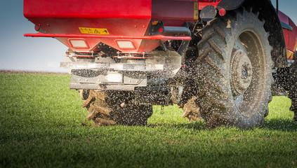 tractor fertilizing in field