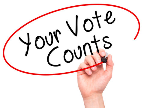Man Hand writing Your Vote Counts with black marker on visual sc
