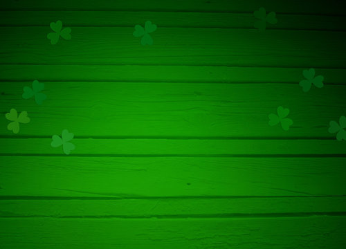St. Patricks day greeting card, mock up scene with empty space, wooden background and clover leaves