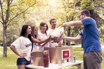 volunteer group receives food donation