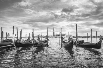 Gondolas in lagoon of Venice and San Giorgio island in background, Italy, Europe, black and white