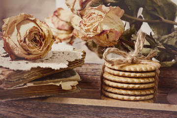 Vintage old books, roses and cake