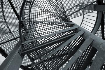 Tuinposter Aan het plafond Abstract industrial background with steel spiral ladder