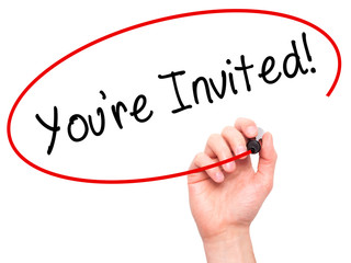 Man Hand writing You're Invited! with black marker on visual scr