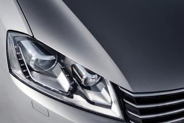 close up headlight of grey car at daytime