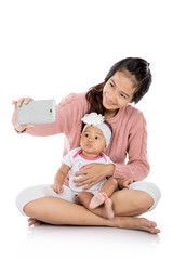 Woman with her baby taking selfie together