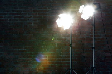 Studio light flashes on brick wall background