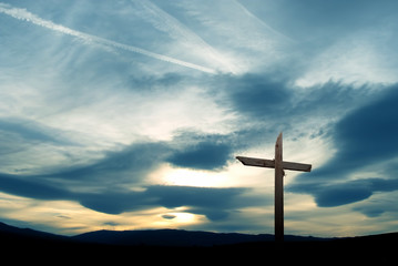 Christian cross over beautiful sky