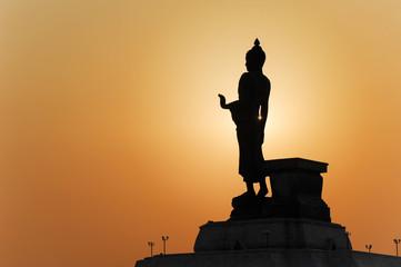 Buddha silhouette on sunrise