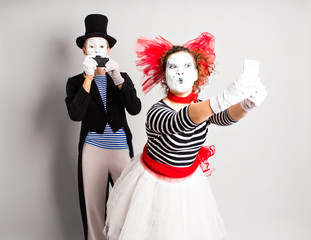 I love selfie. Mime holding camera and making selfie. April Fool's Day concept
