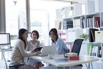 Female company employee has a full meeting