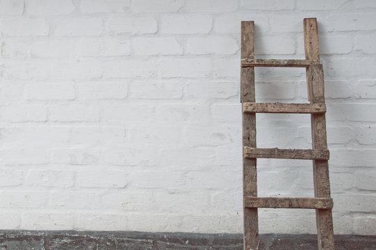 dirty ladder near the wall