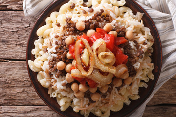 Egyptian Cuisine: kushari close-up on the plate. horizontal top view