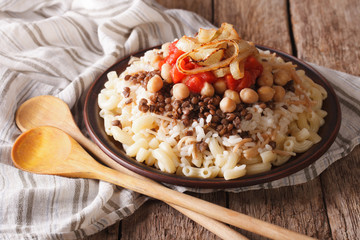 Arabic cuisine: kushari of rice, pasta, chickpeas and lentils close up
