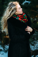beautiful girl in winter Christmas photo shoot at the park
