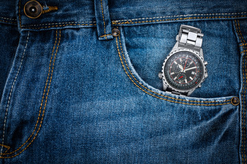 Chronograph watch in jeans pocket , Time in jeans pocket