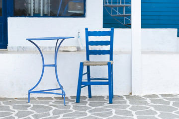 Blue Table and chair in the streets of Karpathos, Greece