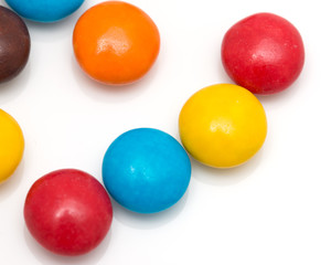 colorful round candy on a white background