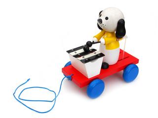 Jouet en bois à roulettes (chien musicien)