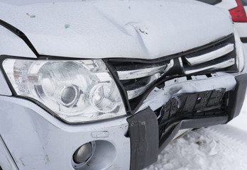 Front part of crashed car. Winter