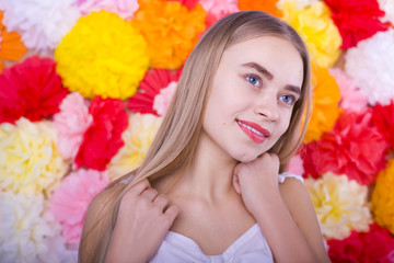 beautiful blue-eyed girl on a colored background