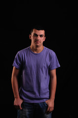Portrait of young man wearing t-shirt looking at camera