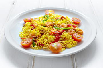 Dish of noodles with prawns and vegetables