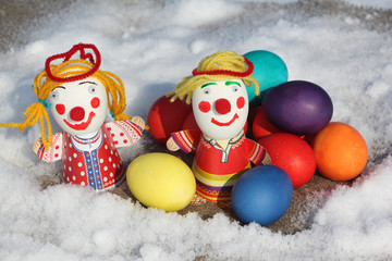Color Easter eggs with a toy figure of the little man on a napki