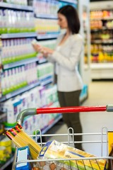 Woman looking at product in aisle