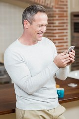 Handsome man looking at smartphone