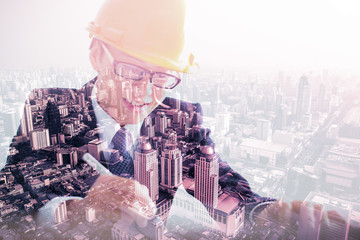 Double exposure of Architect sketching a construction project an