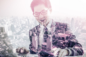 Double exposure of Handsome businessman working with laptop and