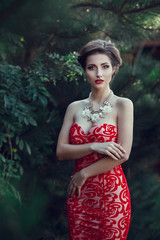 Beautiful lady in red dress in the restaurant.