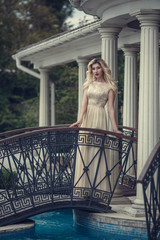 fashion outdoor photo of elegant beautiful woman with blond hair