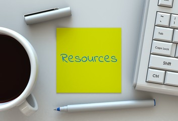Resources, message on note paper, computer and coffee on table