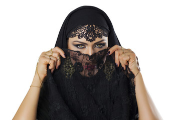 Beautiful caucasian young woman with black veil on face