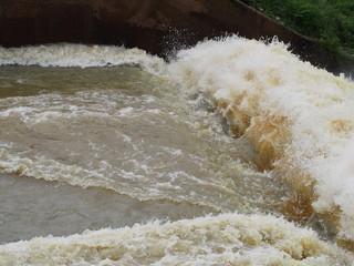 Turbulent  flow of water pass a weir after the rain